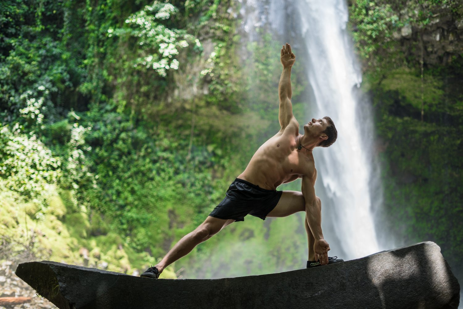 man doing yoga in costa rica